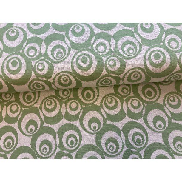 Jaquard med stræk, lys bund med grønne cirkler. 40 kr ( 1 enhed er 1 meter)
