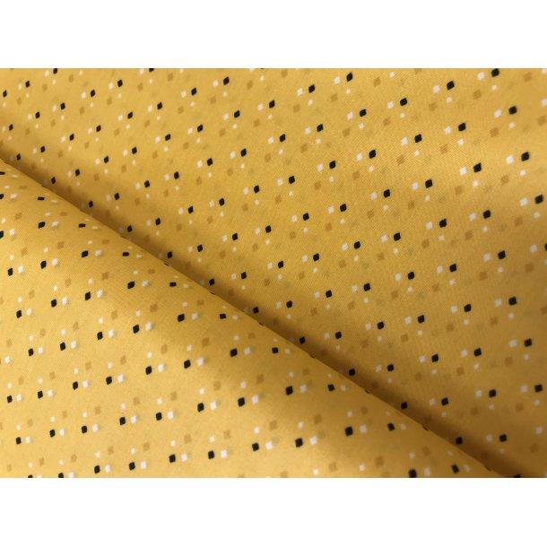 100 % BOMULD FAST, Sort, hvid, gylden firkantede pletter på gul bund. 69 kr. pr. m.