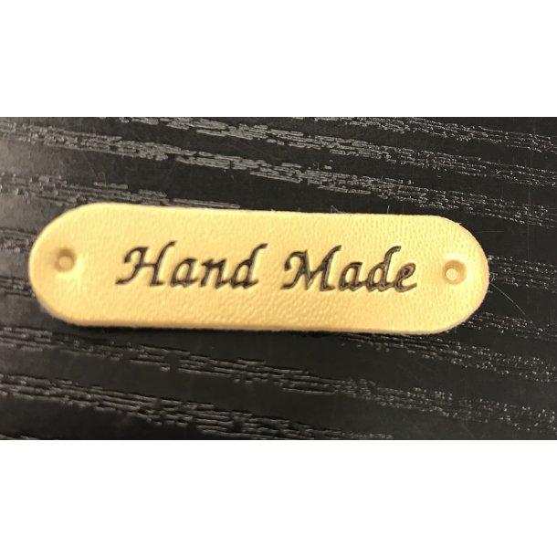 Hand Made symærke kunstskind. GULD. 4,50 x 1 cm. 8 kr.