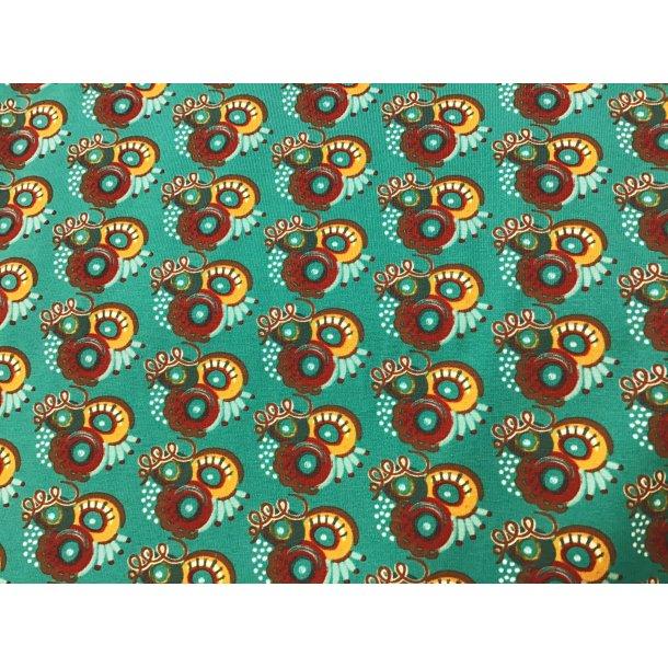 Jersey, brun/karry fantasi mønster, cirkler, prikker, stave (lidt svær at forklare), blå/grøn bund