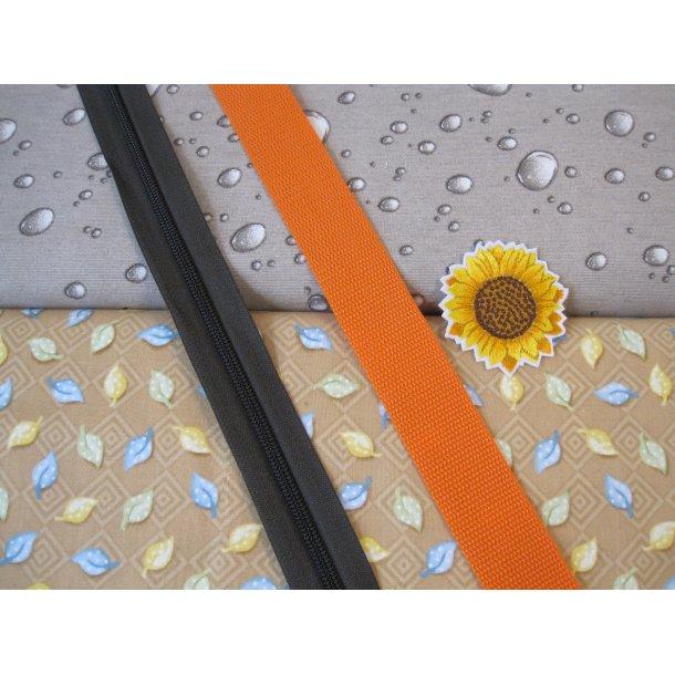 Bumbag pk. Grå dråbe, blade på sand bund, sort lyn/orange gjord, solsikke mærke